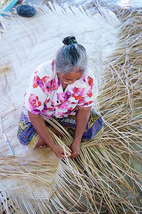 Western Samoa, Manono Island, woman weaving mat
