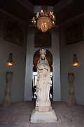 A statue in the main entryway greets visitors to the home Gertrude Zachary in downtown Albuquerque. ..CREDIT: Steven St. John for The Wall Street Journal