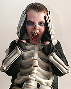 Young boy dressed up as a skeleton