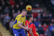 Accrington Stanley defender Tom Davies  beats York City forward Vadaine Oliver  in the air during the Sky Bet League 2 match between York City and Accrington Stanley at Bootham Crescent, York, England on 28 November 2015. Photo by Simon Davies.