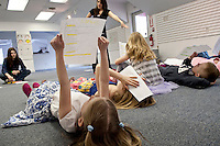 """Sophie Pankhurst finds that """"her nose is cold and her toes are numb"""" as she looks over her lines in the poem """"Sick"""" by Shel Silverstein during Wednesday mornings session of the Winnipesaukee Playhouse Vacation Week Theater Camp in Meredith.  (Karen Bobotas/for the Laconia Daily Sun)"""