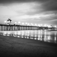 Picture of Huntington Beach Pier with storm clouds in black and white. Huntington Beach is a popular Southern California coastal city in the Western United States.