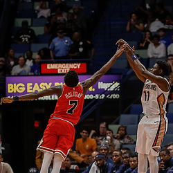 Oct 3, 2017; New Orleans, LA, USA; New Orleans Pelicans guard Jrue Holiday (11) shoots over Chicago Bulls guard Jerian Grant (2) during the second quarter of a NBA preseason game at the Smoothie King Center. Mandatory Credit: Derick E. Hingle-USA TODAY Sports