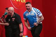 Gerwyn Price hits a 180 and celebrates during the Ladrokes UK Open 2019 at Butlins Minehead, Minehead, United Kingdom on 1 March 2019.