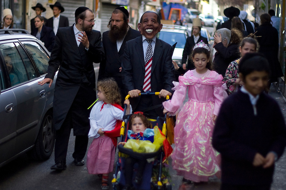 Ultra-Orthodox Jews celebrate the Jewish feast of Purim in Jerusalem's conservative Mea Shearim neighborhood on March 01, 2010. Purim commemorates the salvation of the Jews from the ancient Persians as described in the book of Esther. Photo by Olivier Fitoussi