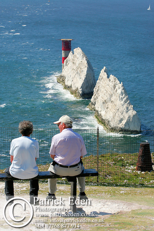 Isle of Wight, needles, Tourist at the Battery looking at the Lighthouse Photographs of the Isle of Wight by photographer Patrick Eden photography photograph canvas canvases