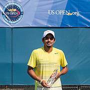August 16, 2014, New Haven, CT:<br /> Sanam Singh poses for a photograph with the trophy after defeating Jeff Dadamo in the 2014 US Open National Playoffs Men's final on day four of the 2014 Connecticut Open at the Yale University Tennis Center in New Haven, Connecticut Monday, August 18, 2014.<br /> (Photo by Billie Weiss/Connecticut Open)