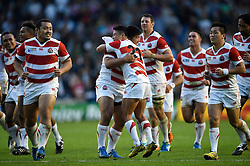 The Japanese team celebrate at the final whistle - Mandatory byline: Patrick Khachfe/JMP - 07966 386802 - 19/09/2015 - RUGBY UNION - Brighton Community Stadium - Brighton, England - South Africa v Japan - Rugby World Cup 2015 Pool B.