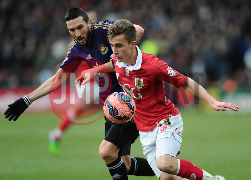 Bristol City's Joe Bryan battles for the ball with West Ham's Morgan Amalfitano  - Photo mandatory by-line: Joe Meredith/JMP - Mobile: 07966 386802 - 25/01/2015 - SPORT - Football - Bristol - Ashton Gate - Bristol City v West Ham United - FA Cup Fourth Round