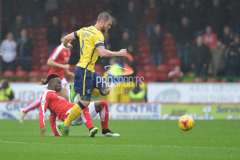 Swindon Town midfielder Drissa Traore tackles Scunthorpe United defender Scott Wiseman during the Sky Bet League 1 match between Swindon Town and Scunthorpe United at the County Ground, Swindon, England on 14 November 2015. Photo by Mark Davies.