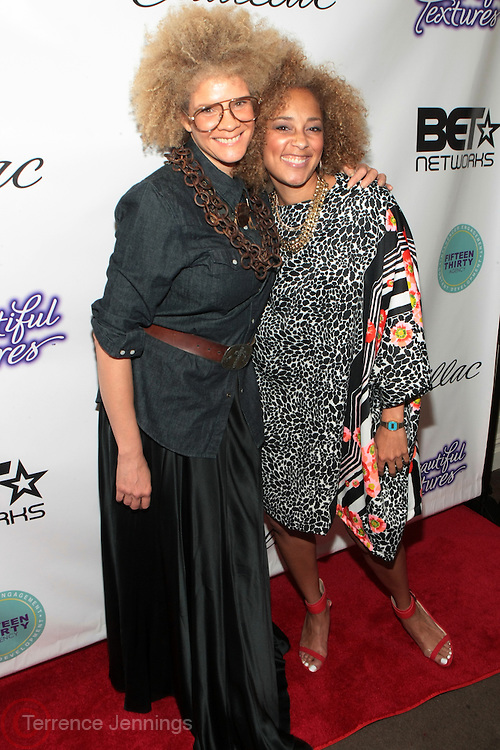 """9 September 2013- New York, NY: (L-R) Media Personalty/Writer Michaela Angela Davis and Recording Artist/DJ/Media Personality Amanda Seales attends the """" Hair Icon '  Cocktail & Dinner party presented by Beautiful Textures in partnership with BET Networks and Cadillac held at the Mondrian Soho Penthouse on September 9, 2013 in New York City. ©Terrence Jennings"""