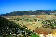 Bezirgan village and farmland in flat land on former lake bed, near Kalkan, Turkey