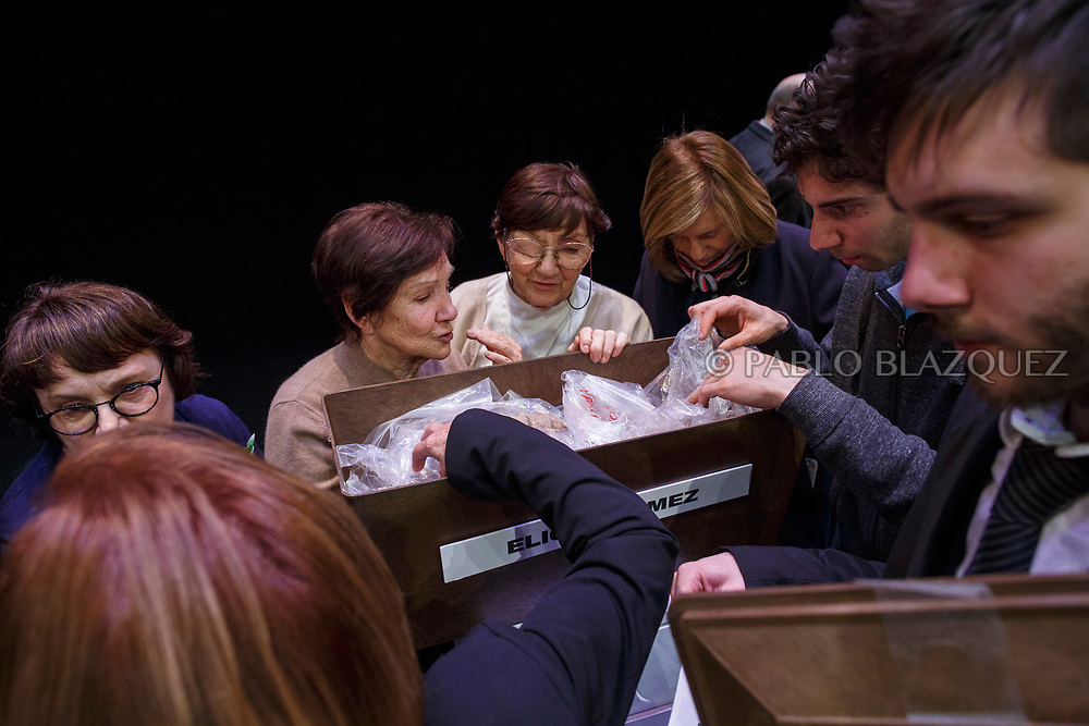 14/04/2018. Relatives check the items of a coffin containing the remains of victim of Spain Civil War Elicio Gomez during a homage to hand the remains of victims of Spain's Civil War exhumed in Cobertelada and Calata&ntilde;azor to their relatives at the Centro Cultural Palacio de la Audiencia on April 14, 2018 in Soria, Spain. La Asociacion Soriana Recuerdo y Dignidad (ASRD) 'The Soria Association for Memory and Dignity' celebrated a tribute to hand over the remains of civil war victims to their families. The Society of Sciences of ARANZADI helped with the research, exhumation and identification of the bodies, after villagers passed the information about the mass grave, 81 years after the assassination took place, to the ASRD. Seven people were assassinated around August 25, 1936 by Falangists, as part of General Francisco Franco armed forces, and buried in the 'Fosa de los Maestros' (Teachers Mass Grave) near Cobertelada, Soria, after being taken from prison of Almazan during the Spanish Civil War. Five of them were teachers in the region, and also friends of Spanish writer Antonio Machado. The other two still remain unidentified. Another body was assassinated by Falangists accompanied by a priest in 1936, and was exhumed on 23 September of 2017 near Calata&ntilde;azor, Soria. It belonged to Abundio Andaluz, a politician, lawyer and musician in Soria.<br /> Spain's Civil War took the lives of thousands of people on both sides, and civilians. But Franco continued his executions after the war has finished. Teachers, as part of the education sector, were often a target of Franco's forces. Spanish governments has never done anything to help the victims of the Civil War and Franco's dictatorship while there are still thousands of people missing in mass graves around the country. (&copy; Pablo Blazquez)