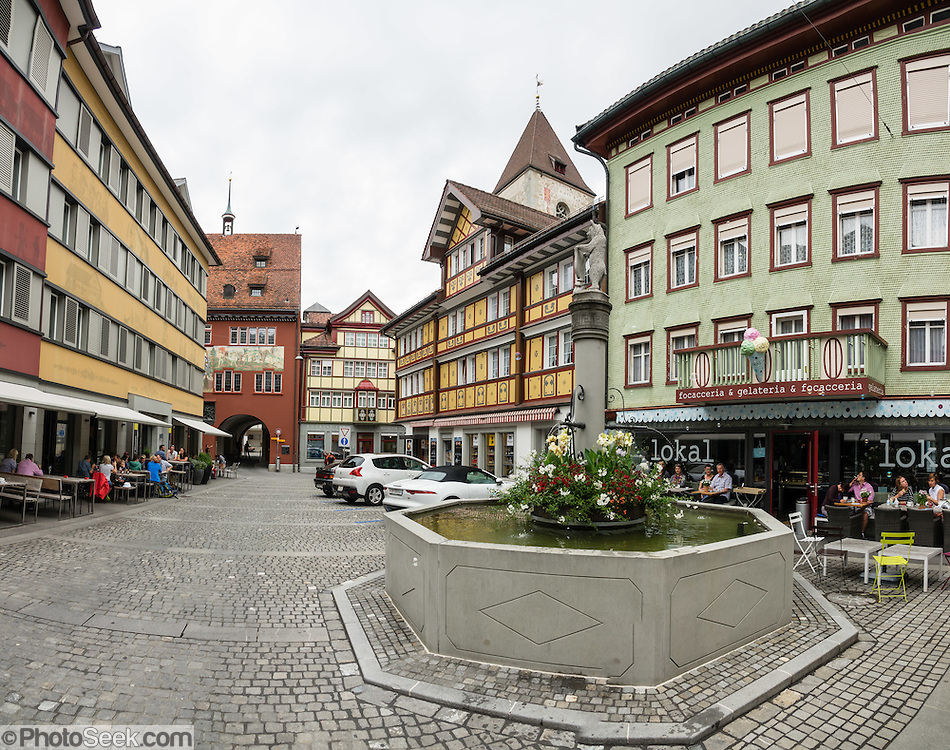 Frescoes decorate buildings on Poststrasse in Appenzell village, in Switzerland, Europe. Appenzell Innerrhoden is Switzerland's most traditional and smallest-population canton (second smallest by area). This image was stitched from multiple overlapping photos.