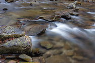 River flowing rapidly over a line of stones that reach across the water, Great Smoky Mountains National Park