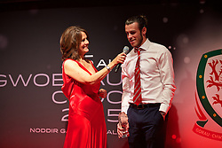 CARDIFF, WALES - Monday, October 5, 2015: Wales' Gareth Bale is interviewed on stage by Frances Donovan after winning the Men's Fans Favourite Award during the FAW Awards Dinner at Cardiff City Hall. (Pic by David Rawcliffe/Propaganda)c