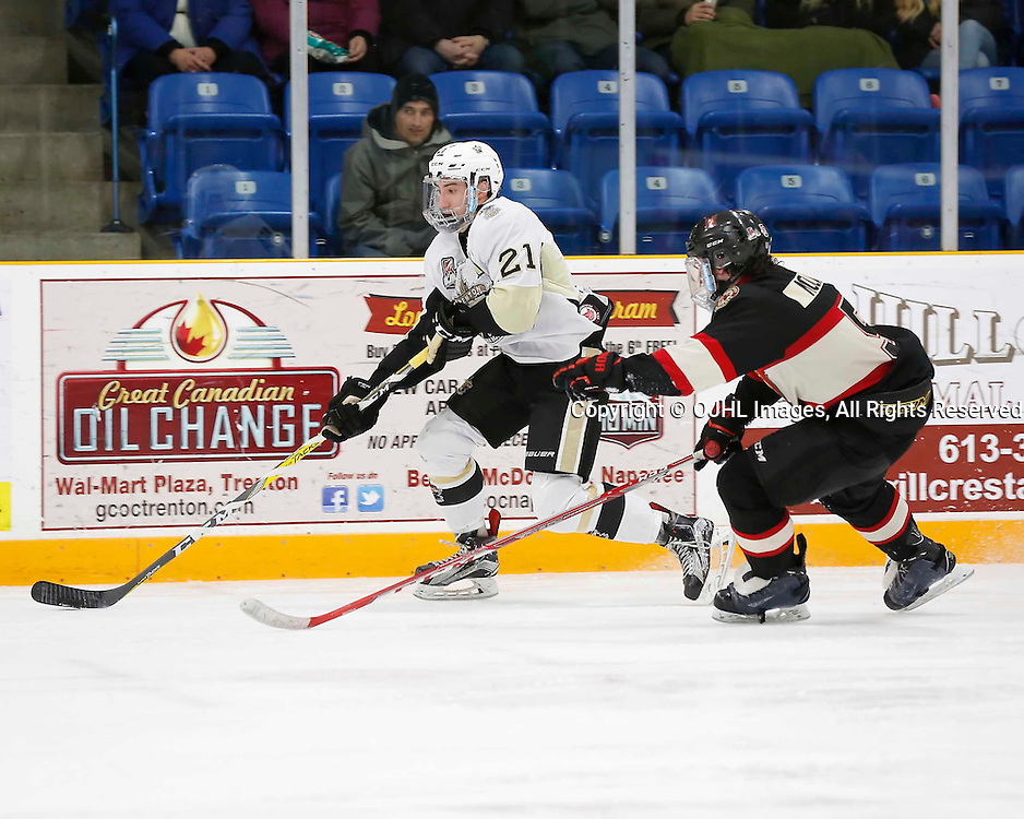 TRENTON, ON - MAR 3,  2017: Ontario Junior Hockey League, playoff game between the Trenton Golden Hawks and the Newmarket Hurricanes., Jeremy Pullara #21 of the Trenton Golden Hawks skates with the puck during the third period<br /> (Photo by Amy Deroche / OJHL Images)