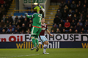 David Marshall of Cardiff City manages to get to the ball just ahead of Sam Vokes of Burnley during the Sky Bet Championship match between Burnley and Cardiff City at Turf Moor, Burnley, England on 5 April 2016. Photo by Simon Brady.