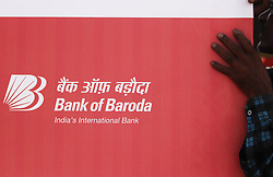 May 4, 2019 - Mumbai, India - A man holds a banner of Bank of Baroda in Mumbai, India on 04 May 2019. As the public sector bank has celebrated his centennial anniversary of Mumbai Zone. (Credit Image: © Himanshu Bhatt/NurPhoto via ZUMA Press)