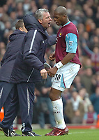 Photo: Ed Godden.<br />West Ham United v Chelsea. The Barclays Premiership.<br />02/01/2006. <br />Marlon Harewood (R) is given some orders from West Ham manager Alan Pardew.