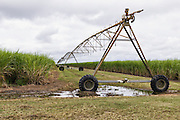 Mobile lateral move irrigation boom system in field of sugar cane in Bundaberg, Queensland, Australia.