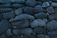 Lava rock stones stacked to form a wall near on Hawaii, the big island.
