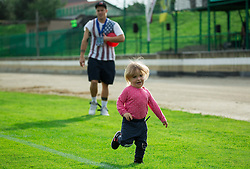 Nejc Vidmar of Domzale with his daughter during football match between ND Ilirija 1911 and NK Domzale in Round #2 of Slovenian Cup 2015/16, on September 16, 2015, in Sports park Ilirija, Ljubljana, Slovenia. Photo by Vid Ponikvar / Sportida
