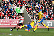 Kyle Storer scores and celebrates  during the Vanarama National League match between Cheltenham Town and Lincoln City at Whaddon Road, Cheltenham, England on 30 April 2016. Photo by Antony Thompson.