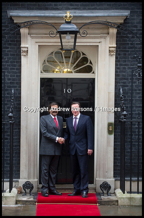British Prime Minister David Cameron greets the Emir of Qatar, Sheikh Hamad bin Khalifa Al Thani (L) at Number 10 Downing Street on January 22, 2013 in London, England. During his meeting with Prime Minister Cameron at Downing Street, the Emir of Qatar is expected to discuss the situations in Syria and Iran as well as the Emir's business interests in the UK. Mr Cameron is due to deliver a long-awaited speech on Britain's relationship with the EU tomorrow. Photo By Andrew Parsons / i-Images