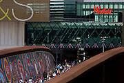 Spectator crowds descend steps at the Westfield City shopping complex, Stratford that leads to the Olympic Park during the London 2012 Olympics, the 30th Olympiad. Situated on the fringe of the 2012 Olympic park, Westfield is Europe's largest urban shopping centre providing the main access to the Olympic park with a central 'street' giving 75% of Olympic visitors access to the main stadium so retail space...