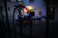 """A horse drawn buggy rides through the streets of the """"Old City"""" in Cartagena, a unique travel destination on Colombia's Caribbean coast. (Photo/Scott Dalton)"""