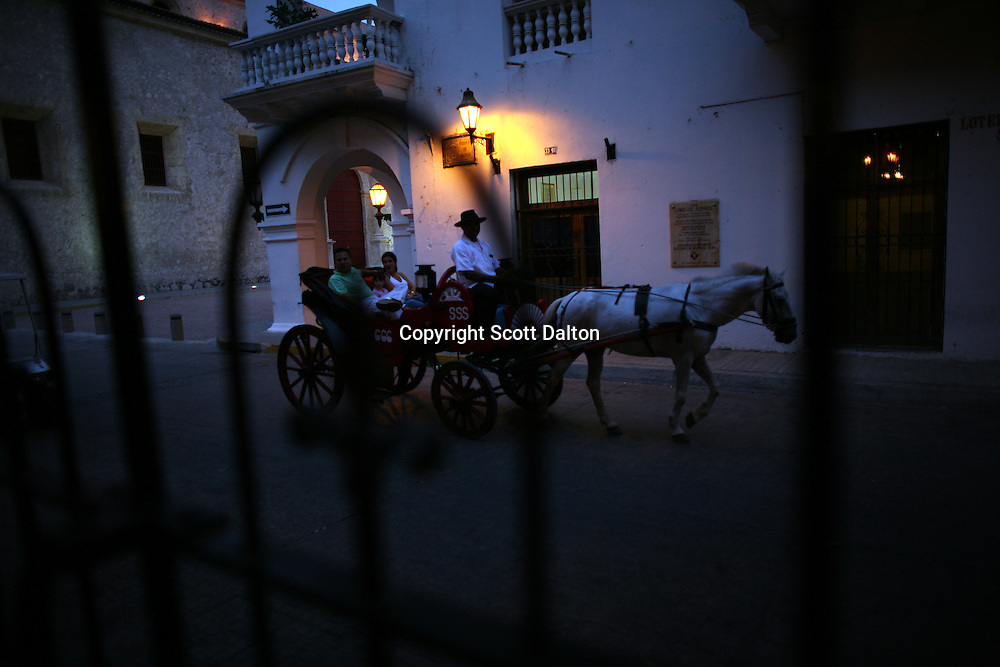 "A horse drawn buggy rides through the streets of the ""Old City"" in Cartagena, a unique travel destination on Colombia's Caribbean coast. (Photo/Scott Dalton)"