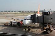 Easy Jet aeroplane boarding passengers on a runway at Barcelona Airport. Barcelona. Spain 2013