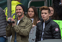 The whole Beckham family in the grandstand cheering 12 year old Romeo Beckham on as he competes in the U13 boys race in the Virgin Giving Mini London Marathon , Sunday 26th April 2015.<br /> <br /> Dillon Bryden for Virgin Money London Marathon<br /> <br /> For more information please contact Penny Dain at pennyd@london-marathon.co.uk