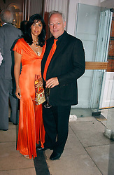Musician DAVID GILMOUR and his wife writer POLLY SAMPSON at a party to celebrattte the 150th anniversary of Kensington Palace Gardens in aid of the British Red Cross held at The Orangery, Kensington Palace, London on 7th July 2004.