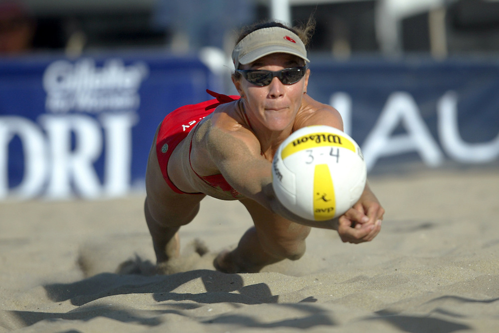 AVP Professional Volleyball - Huntington Beach, CA - August 16th - 17th, 2003 - Leanne McSorley dives for a ball in an AVP beach volleyball tournament held in Huntington Beach, CA - Photo by Wally Nell/DIG Magazine