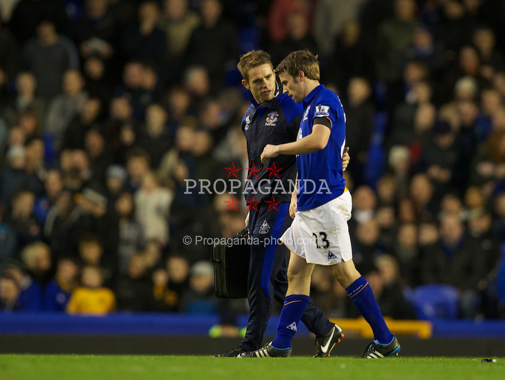 LIVERPOOL, ENGLAND - Saturday, January 7, 2012: Everton's Seamus Coleman limps off the pitch injured during the FA Cup 3rd Round against Tamworth match at Goodison Park. (Pic by David Rawcliffe/Propaganda)