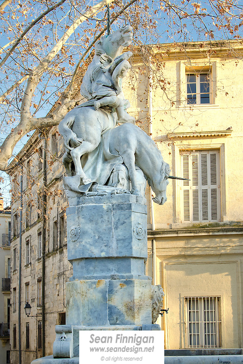 The unicorn fountain set among the nettle trees of Place de la Canourgue, a quiet square in the centre of Montpellier. The statue sculpted by Étienne d'Antoine was erected in 1776. It represents the arms of the Castries family. This site was also once the lodging of religious friars from Maguelone.