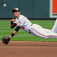 8 September 2013:  Baltimore Orioles second baseman Ryan Flaherty (3) throws to first after leaving his feet on a ground ball against the Chicago White Sox at Camden Yards in Baltimore, MD. where the Chicago White Sox defeated the Baltimore Orioles, 4-2.