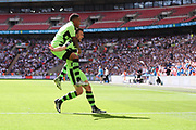 Forest Green Rovers Christian Doidge(9) scores a goal 2-0 and celebrates with Forest Green Rovers Keanu Marsh-Brown(7) during the Vanarama National League Play Off Final match between Tranmere Rovers and Forest Green Rovers at Wembley Stadium, London, England on 14 May 2017. Photo by Shane Healey.