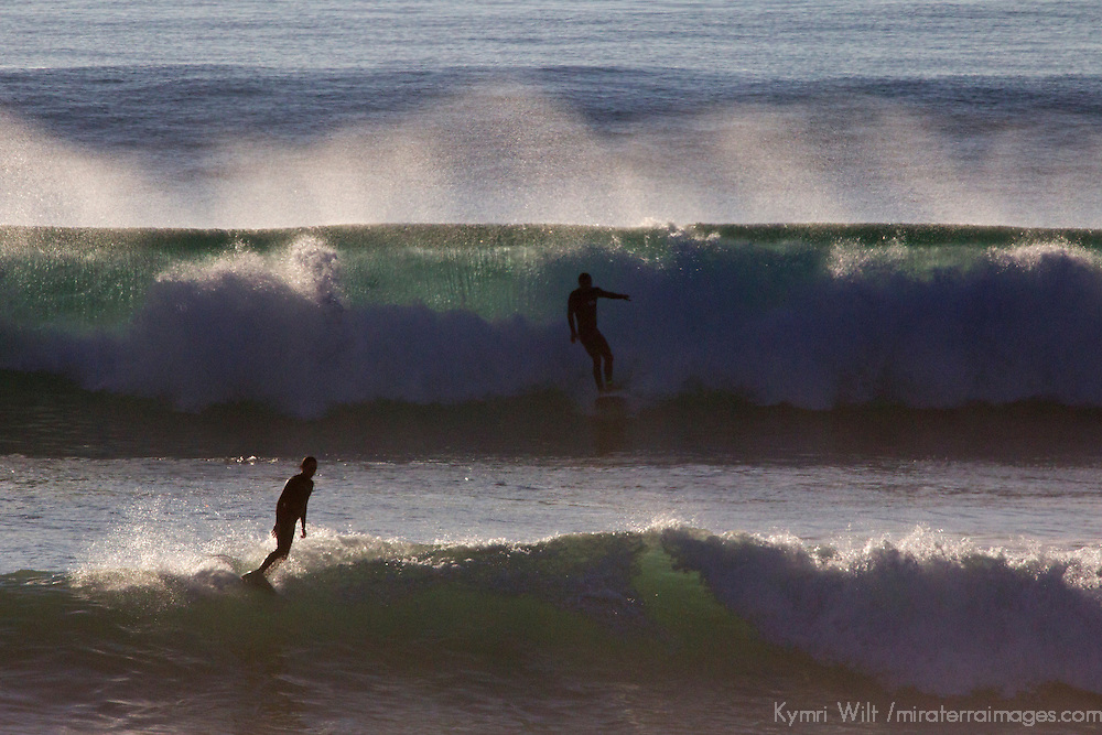 USA, California, San Diego. Surfers on waves at Cardiff by the Sea.