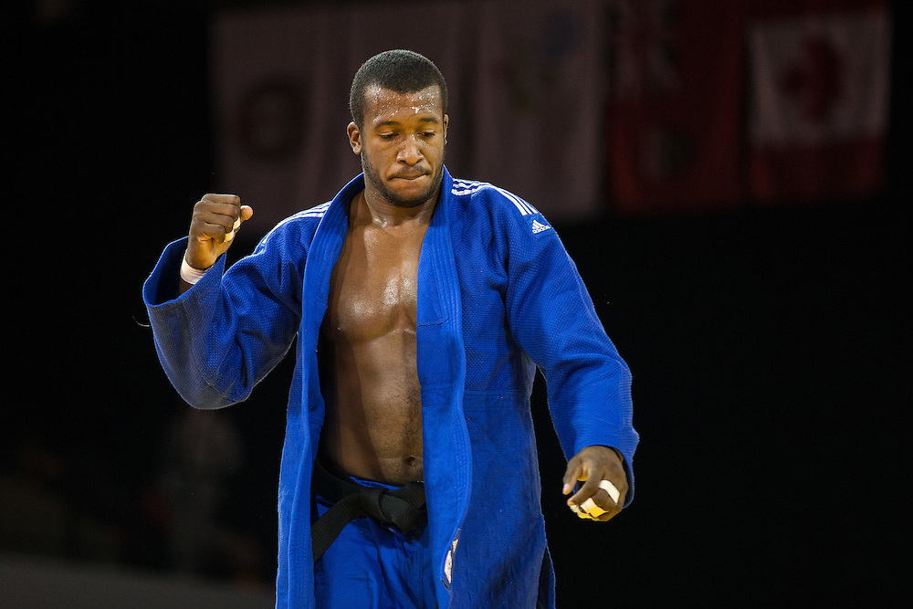 Jose Armenteros of Cuba celebrates after defeating  Antony Pena of Venezuela to win the bronze medal contest in the mens judo -100kg class at the 2015 Pan American Games in Toronto, Canada, July 14,  2015.  AFP PHOTO/GEOFF ROBINS
