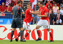 Referee Pieter Vink pointed to penalty shot and Emanuel Pogatetz does not agree, Jurgen Saumel is calming him down during the UEFA EURO 2008 Group B soccer match between Austria and Croatia at Ernst-Happel Stadium, on June 8,2008, in Vienna, Austria.  (Photo by Vid Ponikvar / Sportal Images)