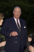 The Earl  of Cadogan, Cartier Flower show dinner, Chelsea Physic garden, 24 May 2004. ONE TIME USE ONLY - DO NOT ARCHIVE  © Copyright Photograph by Dafydd Jones 66 Stockwell Park Rd. London SW9 0DA Tel 020 7733 0108 www.dafjones.com