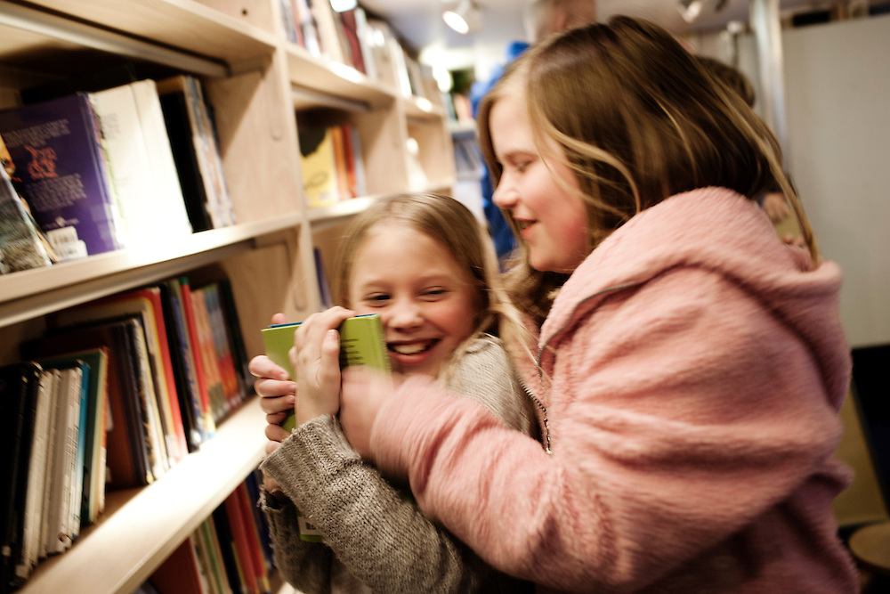Girls in friedly fight over a book...Photo by Knut Egil Wang /MOMENT