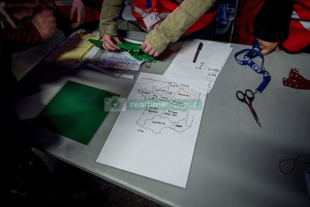 October 24, 2016 - Calais, France - The map of France divided in regions to explain to migrants the location of their future center in Calais, France, on 24 October 2016. One third of the migrants living in the Jungle was today registered and dispatched vias various regions of the French territory. They were asked to queue in front of a warehouse where they were given a bracelet with a specific colour. They eventually got into their allocated bus. (Credit Image: © Guillaume Pinon/NurPhoto via ZUMA Press)
