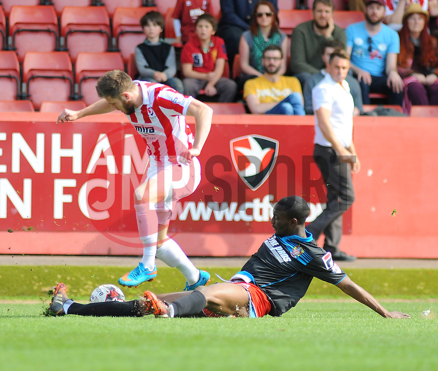 Cheltenham Town's Wes Burns gets tackled by Stevenage's Bira Dembele. - Photo mandatory by-line: Nizaam Jones - Mobile: 07966 386802 - 06/04/2015 - SPORT - Football - Cheltenham - Whaddon Road - Cheltenham Town v Stevenage - Sky Bet League Two