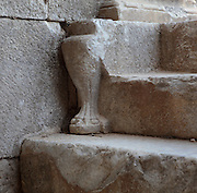 Sculpted detail on the steps of the Hellenistic theatre, 4th century BC, later enlarged by the Romans in the 2nd century AD, Miletus, Aydin, Turkey. The new building under Emperor Trajan seated 25,000 and a third floor was added to the stage building, which was decorated with columns and hunting scenes with Eros. In the centre of the first two rows, four columns designated a special box for the emperors. The theatre was situated on the edge of the harbour. Miletus was an Ancient Greek city on the Western coast of Anatolia. Although settlement began here millennia ago, its heyday was in the Hellenistic and Roman periods. The city was finally abandoned in the Ottoman era when the harbours silted up. Picture by Manuel Cohen