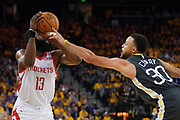 April 30, 2019; Oakland, CA, USA; Golden State Warriors guard Stephen Curry (30) blocks the shot of Houston Rockets guard James Harden (13) during the second quarter in game two of the second round of the 2019 NBA Playoffs at Oracle Arena.