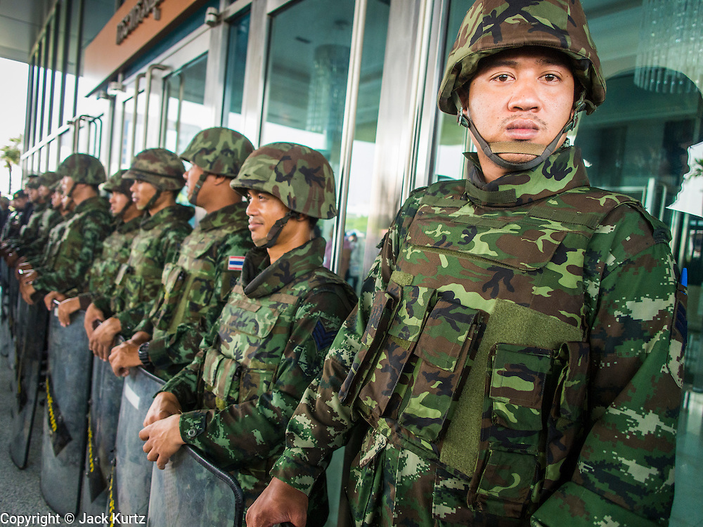 "08 APRIL 2014 - BANGKOK, THAILAND:  Thai soldiers guard the Ministry of Justice in Bangkok. Several hundred anti-government protestors led by Suthep Thaugsuban went to the Ministry of Justice in Bangkok Tuesday. Suthep and the protestors met with representatives of the Ministry of Justice and expressed their belief that Thai politics need to be reformed and that corruption needed to be ""seriously tackled."" The protestors returned to their main protest site in Lumpini Park in central Bangkok after the meeting.   PHOTO BY JACK KURTZ"
